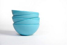 Stack Of Bright Blue Dishes Cl...