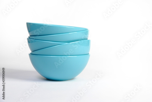 stack of bright blue dishes close-up isolated on a white background