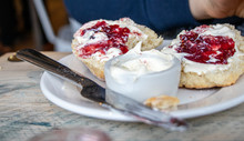 A Scone With Clotted Cream And...
