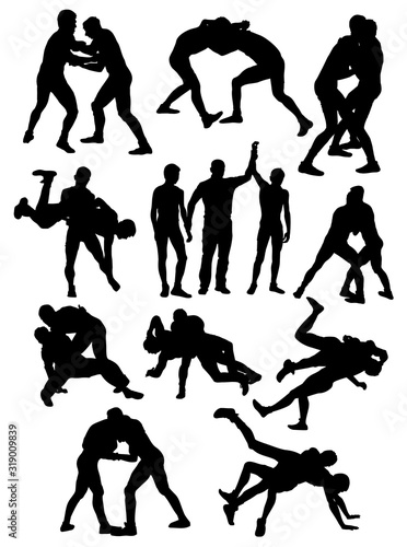 silhouettes of Greco Roman wrestling athletes vector Canvas Print