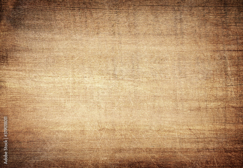 Obraz Brown scratched wooden cutting board. Wood texture - fototapety do salonu