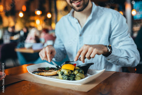 close up of man having lunch in restaurant