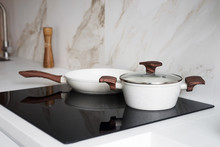 Pot And Pan On Black Induction Stove In The Kitchen