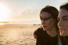 Millennial Woman On Beach Duri...