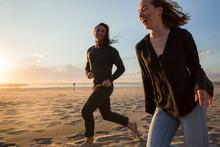 Millennial Couple On The Beach...
