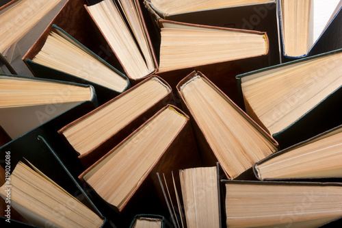 Obraz Old and used hardback books or text books from above. - fototapety do salonu