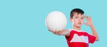 Caucasian Boy Serving The Ball In Volleyball Isolated On A Blue Background