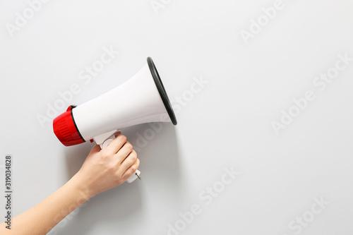 Photo Female hand with megaphone on white background