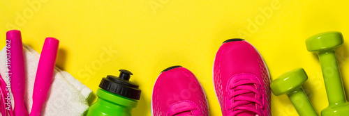Fitness equipment flat lay image on color background. Wallpaper Mural