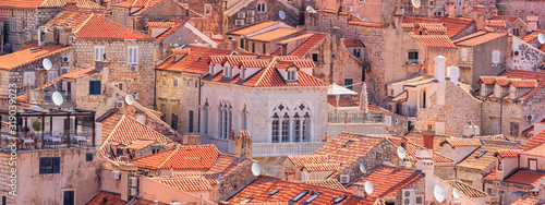 Obraz Summer mediterranean cityscape, banner - view of the roofs of the Old Town of Dubrovnik, on the Adriatic coast of Croatia - fototapety do salonu