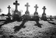 A Row Of Crosses In A Graveyar...