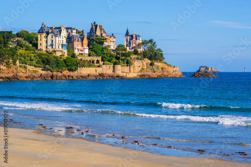 Sand beach and historical villas in Dinard, Brittany, France Fotobehang