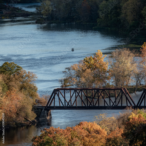 railroad bridge over allegheny river with fisherman in a boat Wallpaper Mural