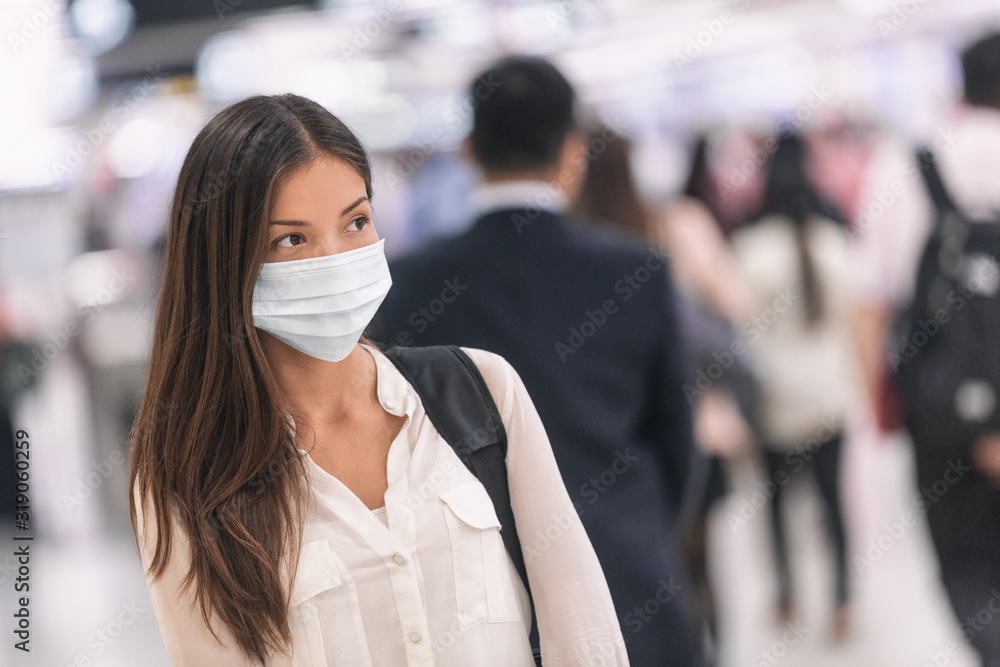 Fototapeta Virus mask Asian woman travel wearing face protection in prevention for coronavirus in China. Lady walking in public space bus station or airport.