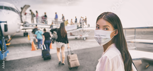 fototapeta na drzwi i meble Airport Asian woman tourist boarding plane taking a flight in China wearing face mask. Coronavirus flu virus travel concept banner panorama.