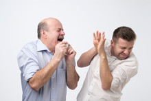 Sick Bald Caucasian Man Holding Napkin Or Tissue, Trying To Cover Mouth While Sneezing