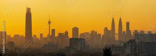 Fototapeta MODERN BUILDINGS IN CITY AGAINST SKY DURING SUNSET obraz