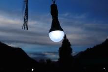 Light Bulb Hanging Against Sky At Dusk