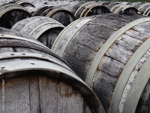 Photo Close-Up Of Barrels In Factory