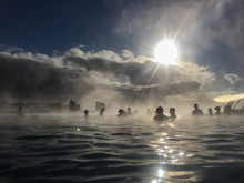Silhouette People In Hot Spring Against Cloudy Sky