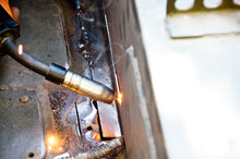 Close-Up Of Machinery Welding Metal