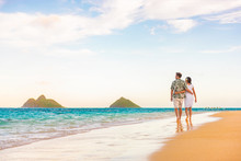 Hawaii Beach Vacation Couple Walking At Sunset Luxury Travel Holiday Honeymoon Destination. Newlyweds Happy On Lanikai Beach, Oahu, Hawaii.