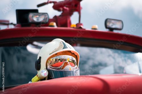 Fotografia, Obraz Low Angle View Of Helmet On Fire Engine