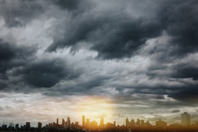 STORM CLOUDS OVER CITY BUILDINGS