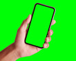 canvas print picture - Studio shot of hand shows mobile smartphone with green screen in vertical position isolated on background. Mock up mobile for Infographic Global Business web site design app, - Clipping Path