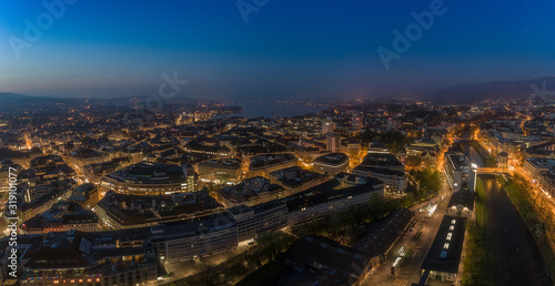 Obraz HIGH ANGLE VIEW OF ILLUMINATED BUILDINGS IN CITY AT NIGHT - fototapety do salonu