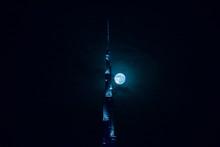Illuminated Burj Khalifa Against Sky At Night