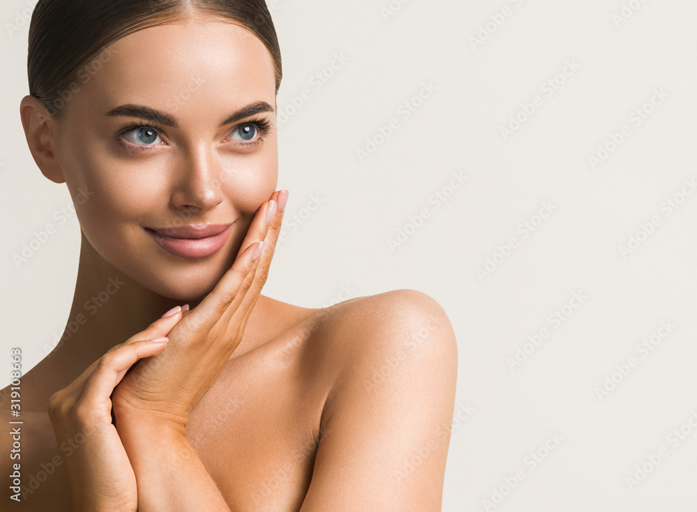 Fototapeta Beautiful woman face close up natural make up hand touching face beauty smile