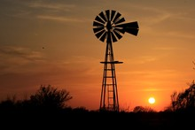 Silhouette Of Windmill At Suns...