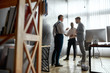 An attitude for business learning. Full-length shot of diverse employees, traders standing near blackboard full of charts, while discussing the strategy of work. Horizontal shot