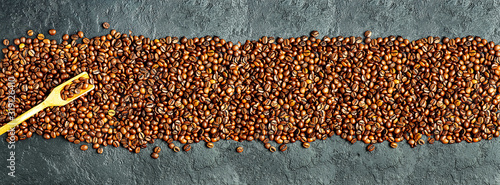 coffee-bean-and-spatula-on-a-black-concrete-background
