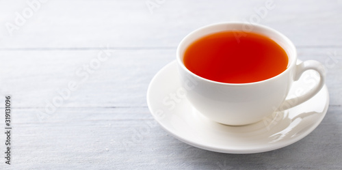 Fototapeta Cup of tea on a grey wooden background. Copy space. Close up. obraz