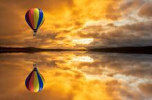 A Hot Air Balloon Over A Lake ...