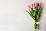 Fototapeta Tulips - Beautiful pink spring tulips on white wooden background, top view. Space for text