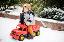 Baby Boy And Toy Car In Winter