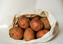 Dirty Potatoes On A White Background