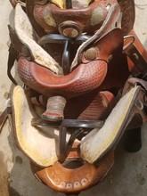 High Angle View Of Saddles On Railing