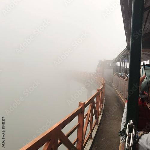 Photo Footbridge Amidst Fog