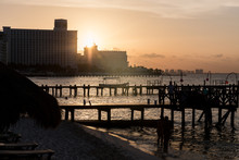 SILHOUETTE OF BUILDINGS AT WATERFRONT
