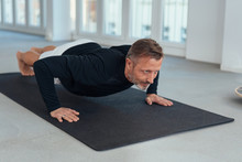 Man Working Out Doing Press Up...