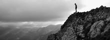 Man Walking On Mountain Against Sky