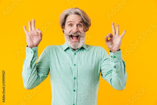Man in blue shirt showing okay gesture. Принти на полотні