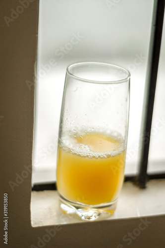 High Angle View Of Juice In Glass On Window Sill