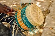 Midsection Of Craftsperson Weaving Basket