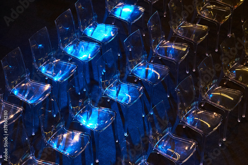 Obraz High Angle View Of Transparent Chairs On Black Floor - fototapety do salonu