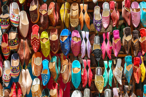 Multicolored traditional handmade shoes at the Moroccan oriental bazaar